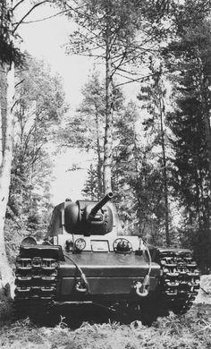 Soviet heavy tank KV-1 in a forest.