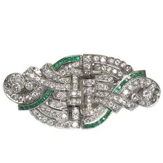 Emerald and Diamond Double Clip   From a unique collection of vintage brooches at https://www.1stdibs.com/jewelry/brooches/brooches/
