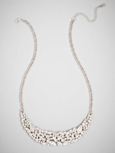 Spectacular sparkle is the main attraction when it comes to this necklace, courtesy of a glittering assortment of crystals cut in all shapes and sizes and fashioned in a sultry crescent moon shape. Style Me Pretty + BaubleBar