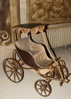 Antique pram in the style of an old carriage, circa 1910.