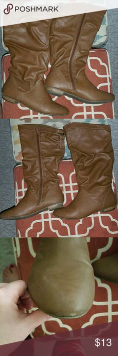 Tan slip on boots Cute tan faux leather boots for running errands around town. Easy to wear slip on boots that has a side functional zipper detailing. GUC.see pictures for condition of boots. Price is firm. Express Shoes