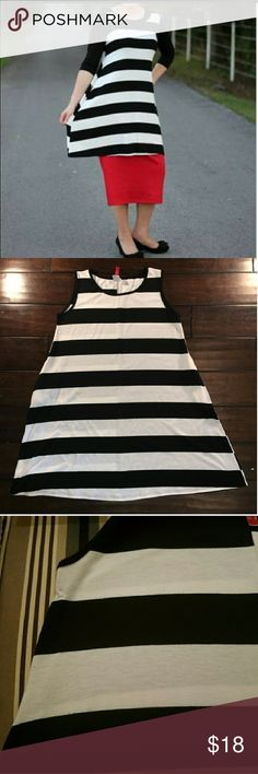 Black and white striped knit top/tunic Sold out at The Modest Poppy (modest boutique). B&W striped knit sleeveless tunic. It was worn once as shown in the pic with s top underneath. NOTE: there is a small tear a fee of centimeters wide on the back of the top. See photos. It has been repaired and in my opinion is not terribly visible. Due to this, I've reduced the price. It's still a very cute top and was only worn once. Smoke free home. 🎀no try one, but will give measurements  🎀no trades…