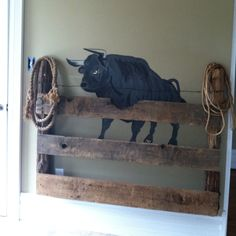 Easy and Fun!! Painted a bull and attached old scrap wood for the fence. Worked well for western style room for our son. Put a hidden bottom on the fence panels and this will also hold books/toys. A few years down the road add a bed frame to the front and ya have a head board for a big boy bed! Rope is plain white rope soaked in coffee for an hour to give the old style western look!