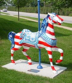 Flag horse by far one of the coolest things I have ever seen. All The Pretty Horses, Beautiful Horses, American Freedom, American Flag, Carosel Horse, Rocking Horses, Painted Pony, Hobby Horse, Merry Go Round
