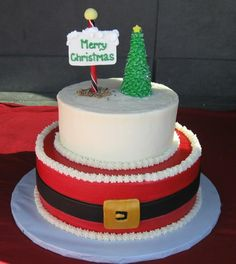 Christmas Cake tiered with Santas belt and one tier with North Pole and Christmas Tree