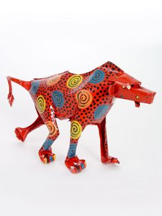 Large Tin Baboon | Handmade in Zimbabwe. $36.00. Old tin cans and other scraps of metal from businesses in the industrial area of Harare are turned into these delightful sculptures by these artists using snips, pliers, and hammers.