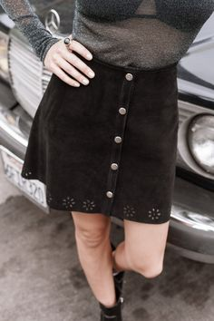 Loving the flower cut out detail on this suede skirt.