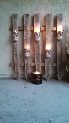 DIY Mason Jar Lantern Ideas for the Backyard | http://diyready.com/fence-with-mason-jar/