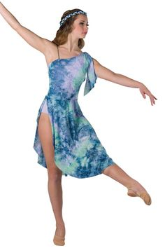 Style# 17403 WATERCOLORS  Glitter printed tie-dye and solid lilac spandex leotard with attached skirt and adjustable nude elastic strap. Separate matching shoulder ties. Binding for hair included. SC-XXLA