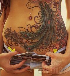 This is probably one of the better stomach tattoos I have seen.  It works well with the curves of the body, covers a significant amount of space, and still leaves enough skin uncovered to show the natural shape of the body.  It is sexy rather than distracting.