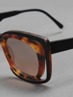 Leather & Feather w/ Kuboraum double shades with brown lenses
