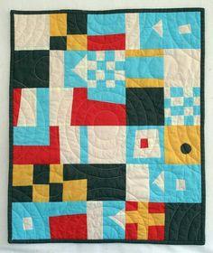 Cute geometric quilt.