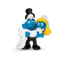 This must be true love. Sweet on her, the groom smurf carries his Smurfette. Together, they look towards a wonderful, blue future. #wedding #partyfavors #favor #married #Smurfs #white #blue $5.98