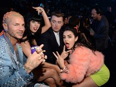 Sam Smith's face looking at Riff Raff is ALL OF OUR COLLECTIVE FACES looking at Riff Raff.   Katy Perry And Sam Smith Deserve This Year's VMA For Greatest Shade This made me giggle quite a bit. Lol. Sam Smith. :)