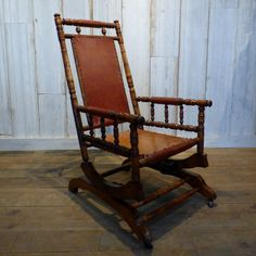 Vintage American turned wood and leather platform rocking chair.  This unusual carved mahogany American platform rocking chair is upholstered in dark red leather. We love the turned wood spindles which have been crafted to resemble bamboo, and the lovely glossy patina which this piece has developed over time.  #cheshire #reclamation #salvage #antiques #collectables #vintage #retro #home #garden #design #interiordesign #furniture #antique #design #reclaimed #rustic #industrial