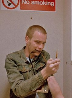 Just adore the cheeky no smoking sign..  Ewan McGregor in Trainspotting. Directed by Danny Boyle, movie released in 1996.