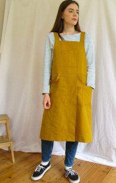 Sturdy cotton canvas, in a warm 'curry' tone, offers good protection for work, home and garden. The split skirt gives lots of movement, whilst ensuring each leg is perfectly covered when sitting at the wheel or work bench. Fantastically comfortable design, with cross back straps, no ties around the neck - bib pocket for small tools, roomy side pocket, loop for cleaning cloth etc. Split Legs, Split Skirt, Back Strap, Cotton Canvas, Apron, Skirts, Handmade, Clothes, Design