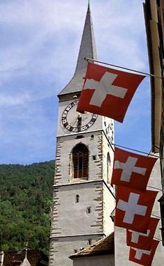 Flags of Graubunden and St Martin Church, Chur, Switzerland Winterthur, Zermatt, Flags Of The World, Our World, Chur Switzerland, Hotels, National Symbols, Geography, Austria