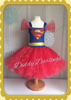 Superman Tutu Dress. Sparkly Superhero Tutu Dress. Beautiful & lovingly handmade.  All characters and colours available Price varies on size, starting from £25.  Please message us for more info.  Find us on Facebook www.facebook.com/DiddyDarlings1 or our website www.diddydarlings.co.uk