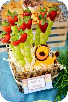 fruit kabobs in a simple basket with florist foam and paper grass for a jungle themed birthday... easy!