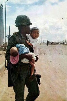 African-American soldier carrying two babies, Vietnam War Nagasaki, Hiroshima, Fukushima, Vietnam War Photos, Vietnam History, North Vietnam, Hanoi Vietnam, We Are The World, American Soldiers