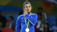 Image copyright                  AP Image caption                                      Kelmendi's victory was a popular success in Rio on Sunday                                When Majlinda Kelmendi sank to her knees in tears at the Olympics on Sunday, it was more than the typical gold medallist's release of tension. It was also a defining moment for Kosovo's 1.8 million people. Eight years after its unilateral declaration of i