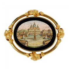 A late 19th century gold micro mosaic brooch. The oval-shape micro mosaic depicting the Vatican, within a scrolling foliate halo. Length 5.5...