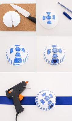 Use a foam ball, blue + black marker, ribbon + a hot glue gun to make this headpiece for your R2D2 costume.