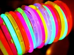 These glowing bracelets remind me of going to Disneyland often as a child. My family lived so close (in Westminster) that we'd go all the time. There are so many good memories attached to Disneyland. It is indeed a happy place for me…    I'd always, toward the end of the night near closing time, buy a bunch of those glow-in-the-dark bracelets, bands, and necklaces. Not sure what they really were called as you could creatively wear them in a number of ways. You'd just buy them in long…