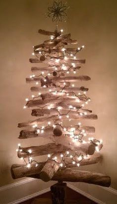 25 Coastal Christmas Holiday Trees Inspired by the Sea!!! Bebe'!!! Love this Simple Rustic Natural Driftwood Christmas Tree for a Rustic Coastal Christmas!!!