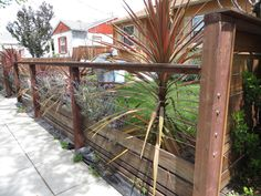 modern low fence with wood at bottom, horizontal wires and nice metal details.