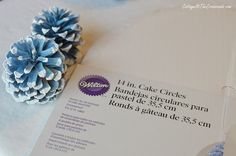 cake circle used as a base for a Christmas pine cone tree