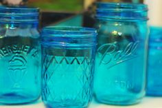 DIY Paint Mason Jars!! 1/4 cup of Mod Podge (glossy) covers 4 small jars and a good amount of food coloring. For lighter color add water. Bake at 175 until transparent, let cool and then spray with clear sealant.