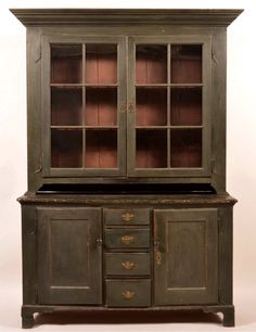 """Conestoga Auctions - June 13, 2015. Lot 856.  Estimate: $4,000 - $6,000. Realized: $8,168.   Description:  Lancaster County PA Country Chippendale Softwood Two Part Dutch Cupboard. Boldly molded cornice, two six pane glazed upper doors, mounted on rat tail hinges, open pie shelf above a molded top base, central row of four graduated lip molded dovetailed drawers, flanked by two molded doors, mounted on wrought iron rat tail hinges, molded base with shaped cut out bracket feet. 83-1/2""""h. x…"""