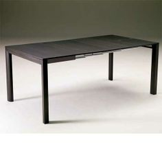 Minima Table expands from console to 8-seat dining table. Resource Furniture.