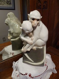 The Wiener Werkstätte was a production community of visual artists in Vienna, Austria bringing together architects, artists and designers - was in production from 1903 to 1932. This rar e, porcelain collector piece sculptor is hand-painted in white featuring a pair of monkeys intertwined sitting on a gray base - slight peach coloring along the faces with yellow/amber glass eyes.   eBay!