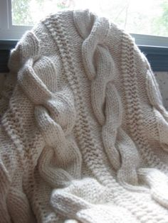 Cable knit throw using chunky yarn (pattern on Ravelry)