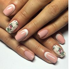 A charming rose nail art design, the cream, and salmon color combination makes a very pretty and homey look with the roses on the design.