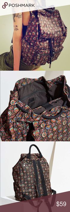 """Paisley Floral Army Canvas Drawstring Backpack Give your style a toughened up utilitarian touch with this ultra-versatile canvas backpack. Roomy cotton canvas bag with cinched drawstring flap-front with magnetic button closure featuring pockets all around, perfect for storing everything you need. With a padded laptop sleeve, back zipper access and 2 front zipped pockets with antique finish metal hardware throughout. Use it for class, weekend  getaways, and more.  Size - Length: 16.38""""…"""