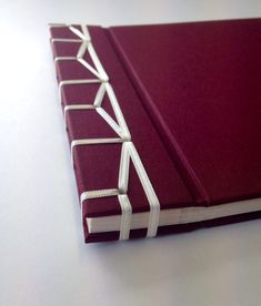 Photo album with Japanese stab binding using ribbon