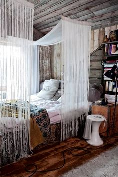 This bohemian style bedroom is perfection paired with deep hardwood floors and…