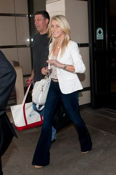 Julianne Hough waves as she arrives at LAX (Los Angeles International Airport).