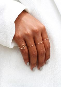 Little gold rings on every finger. We adore this look.