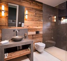 unfinished wood paneling with updated gray bathroom. Golf Brook Home by Pegasus Builders | HomeAdore