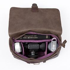 "Kelly Moore Camera Bags for : Camera body + lense and 2 extra lenses Camera body with grip and lense, baby stuff, nappies x 2, baby wipes, baby bottle, pacifier Pro camera body or standard body + grip Camera body with lens attached (up to 9"" total length)"