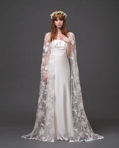 lace wedding cape I don't know wether I like a dark purple cape,a clear cape,or a clear purple cape.