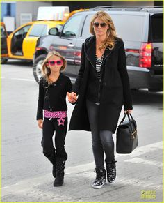 Heidi Klum arrives on a flight at JFK Airport with her daughter Leni on October 5, 2013