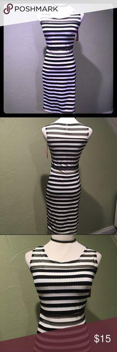 Xhilaration Striped Bodycon Dress Black and white striped Bodycon Xhilaration dress.  Size XS.  New with tags! Xhilaration Dresses Midi