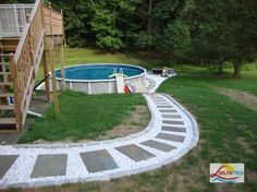 Impressive Image Of Backyard Landscaping Decoration Using Above Ground Round Pool Deck Ideas : Top Notch Picture Of Backyard Landscaping Decoration Using White Above Ground Round Pool Deck Including White Pebble Garden Path And Outdoor Half Turn Oak Wood Staircase