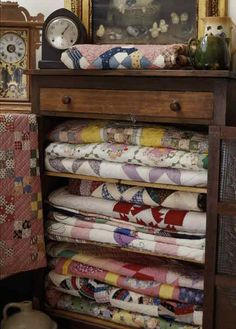4 patch alert - see the one on the cabinet door.  Like the pink setting squares. Caring For Your Quilts
